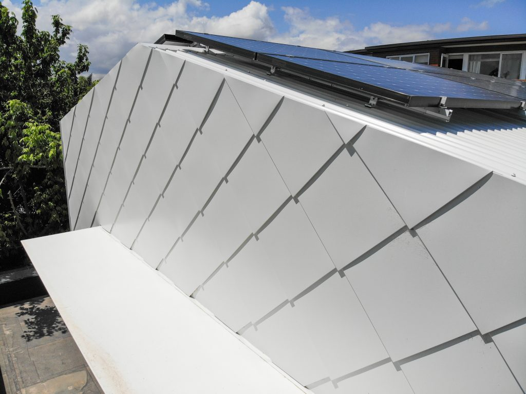 , Making an Impression with Special Metal Shingle Cladding